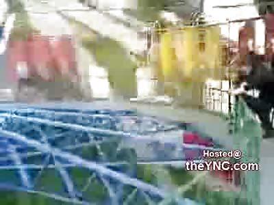 Drunken Russian Idiot Falls off of Carnival Ride
