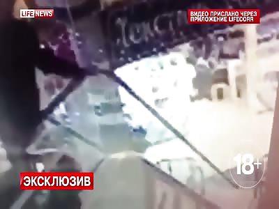 Man Falls to Death From Escalator